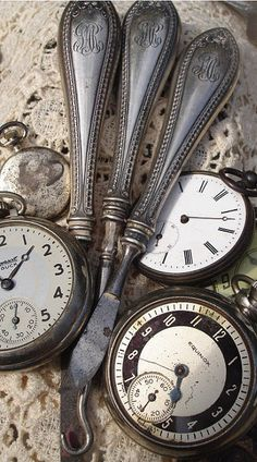 Vintage pocket watches and antique silver flatware