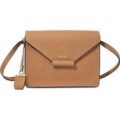 DKNY Bryant Park Edge Flap Crossbody bag (355 SGD) ❤ liked on Polyvore featuring bags, handbags, shoulder bags, brown, beige shoulder bag, brown cross body purse, dkny crossbody, crossbody purse and zipper purse