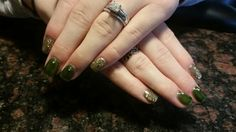 Shellac nails in Pretty Poison with gold glitter and crystals.