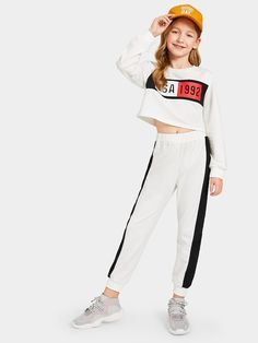 Shop Girls Letter Print Top and Contrast Sideseam Sweatpants Set online. SHEIN offers Girls Letter Print Top and Contrast Sideseam Sweatpants Set & more to fit your fashionable needs. Girls Fashion Clothes, Kids Outfits Girls, Cute Girl Outfits, Kids Fashion, Summer Outfits, Casual Outfits, Fashion Outfits, Two Piece Outfit, Girls Shopping