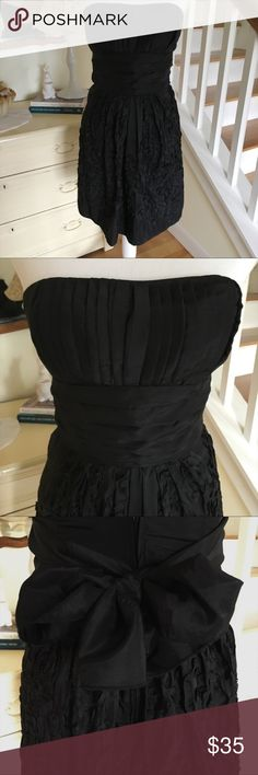 """Alyn Paige Black Strapless Dress This black strapless dress from Alyn Paige features a generous sash, back zipper and rosette covered skirt. Size: 3/4 (super small; fits more like a 0/1/2). Chest: 14"""". Waist: 13"""". Length (back): 24"""". Length (front): 28"""". Sash is 5.75"""" thick. Perfect condition! Alyn Paige Dresses Strapless"""