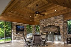 Outdoor living room, patio, screen porch, fireplace, grill, kitchen