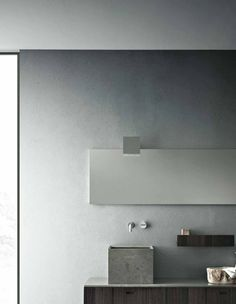 Spice up your bathroom with an extremely contemporary mirror like this one! Loving all the square set features!