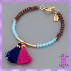 """🎉HP🎉💖GORGEOUS Seed Beads/Tassels Bracelet💖 🎉HOST PICK - WARDROBE REFRESH PARTY - 5/22/2016 - CHOSEN BY: @annaandthelion - (SEVANNA)🎉🎉💖💙💖Fashionable & Stylish Simple Seed Bead Bracelet with Navy Blue & Hot Pink Tassels. The blue and brown wooden seed beads are gorgeous together on this bracelet. It will get noticed. Toggle Closure, Approx. 2.5"""" Diameter💖💙💖PRICE IS FIRM💖💙💖 Boutique Jewelry Bracelets"""
