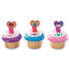 These cupcake rings are themed for the tv show Doc McStuffins. There is a pink ring with Doc McStuffins, a purple ring with Hallie and red ring with Stuffy. The ring part is twisty and looks like a bandaid. These rings measure and you will get 6 assorted. Doc Mcstuffins Party Supplies, Doc Mcstuffins Cupcakes, Doc Mcstuffins Cake, Doc Mcstuffins Birthday, Cupcake Favors, Cupcake Party, Mini Cupcakes, Cupcake Toppers, Cupcake Cakes
