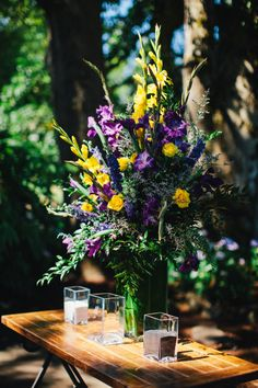 Wedding Floral Arrangement in Purples & Yellows. Photograph by Katy Weaver Photography. #WeddingArrangements #PurpleWedding #DuaneCruz