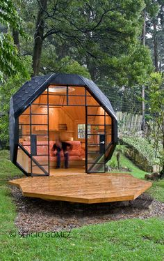 A Mod Outdoor Polyhedron Playhouse: Characterized by its polyhedron shape, expansive views, and even a teak deck, this geometric structure by Manuel Villa is big enough for Mom and Dad to stop by for a visit.