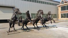 Four horses carriage bronze sculpture.
