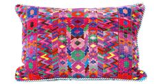 Custom made from a handwoven Guatemalan huipil, or blouse, this colorful pillow is backed and corded in a blue and white cotton stripe, zipper closure.