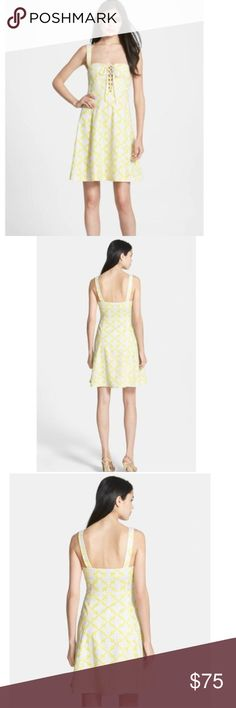 "DVF Yellow Luxe Lace Up Casual Dress Details & Care  A pretty lattice-like print in summery shades brightens an airy cotton eyelet dress cut for a curvy fit-and-flare silhouette. Wide-set shoulder straps frame the low, square neckline, and the corset-style bodice is given a beguiling boost by the lace-up detail at the center front.  Size 2  Length: 36"" from neck to hem, Underarm to underarm: 16"" across, Waist: 13.5"" across.   Lined.  100% cotton.  Dry clean.  By Diane von Furstenberg…"