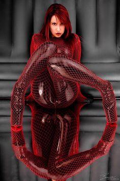 Bianca Beauchamp in latex bodysuit & red fishnet bodysuit.