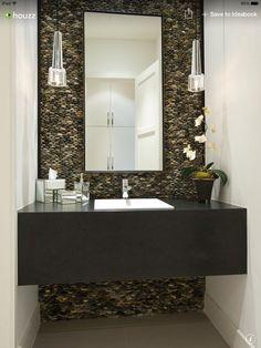 Half bath stacked pebble backsplash, hanging lights & rectangle mirror