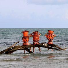 Paula Wilson's caryatids resting on a log.