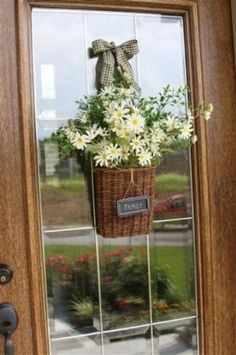 a small basket with fresh flowers can subsitute a usual wreath
