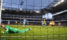 Hart can only look back in anger as the ball nestles in his net and Arsenal head off in ce...
