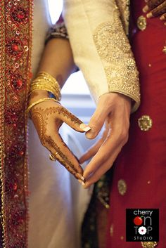 Asian wedding photo. what a brilliant way of taking a pic of their hands. I love this idea