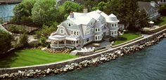 Shingled house on the water with tennis court