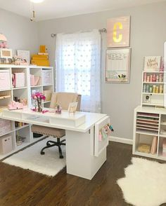 I love how the desk comes out from the bookshelves in this office.