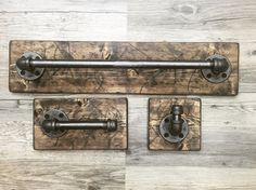 This industrial, rustic, one of a kind bathroom set includes 3 items... a big pipe towel holder, a rope hook and a toilet paper holder, all on wood. The