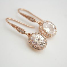 Dainty and small with sparkle, oval Clear Cubic Zirconia detailed drops dangle from cubic zirconia detailed earwires. Material used is rose gold