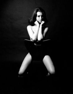 U.K. The famous shot of a naked Christine Keeler astride a copy of a black plastic Arne Jacobsen chair - the chair's back keeping her decent - is often misattributed to David Bailey or Terence Donovan. It was in fact taken by the Hong Kong-born snapper Lewis Morley in an upstairs room at Peter Cook's Establishment Club in Soho during the summer of 1963.