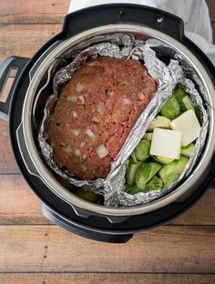 Layer your meatloaf and veggies on top of the potatoes in your Instant Pot and watch the magic happen!