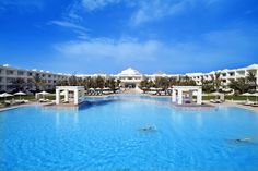 Radisson Blu resort #Djerba enormous outdoor #pool  Guests at this beach resort enjoy the exclusive spa, with features such as Thalassotherapy and seawater basin for relaxation, two swimming pools, a sauna and Jacuzzi. See more images on: http://www.radissonblu.com/resort-djerba/gallery