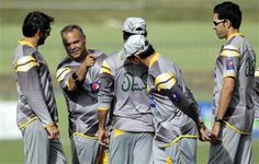 Pakistan's cricket team coach Dav Whatmore, second from left, speaks to players during a practice session ahead of their second one day international cricket match against Sri Lanka, in Pallekale, Sri Lanka,