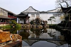 Classic Chinese garden in Suzhou of Song dynasty style. For all but the poor the center of the courtyard was laid out as a garden. While the buildings are geometrically regular, the gardens are irregular offering a naturalistic vision of the countryside beyond. This represents a quest for yin-yang balance where the regular and geometric walls and buildings are yang while the garden in yin. Winding paths; glazed plant pots; water and rocks are important elements of the traditional garden.