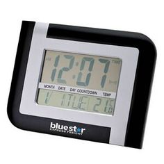 "Large 2"" number LCD desk or wall clock with time, day/date, temperature and countdown features. 10 3/8"" W x 8"" H x 1 1/4"" D"