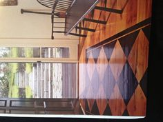 I love the look of the painted design on the wood floor.  But it would be a major decision...not easily reversed.  Take this idea and think about your wood cabinets....a wood door....a wood piece of furniture!!