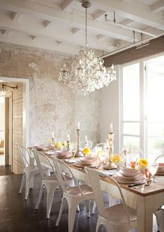 The light, the doors that open to the outside, the beams, the farm table, the chandelier, the textured walls and yes, the light again....  the whole room is AMAZING.