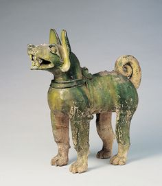 Green-glazed dog Eastern Han dynasty (25–220 CE) Clay with green glaze H. 40.2 cm, L. 40 cm  Excavated from Donggu River, Gaotang Collection of Shandong Provincial Museum