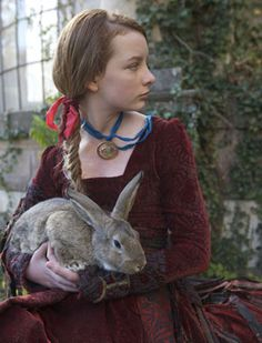 Maria Merryweather holding Serena the hare in The Secret of Moonacre. (looks like a Flemish Giant)