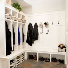 Mudroom with hanging bays painted in Benjamin Moore's gray Owl. Houzz via Atticmag
