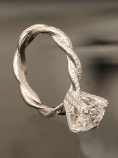 Engagement Ring. Love this.  Probably way too expensive, but it is so unique!