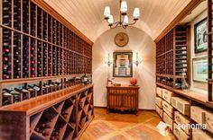 Sonoma Building Company Wine Cellar - barrel vault ceiling, mahogany racking and inlaid brick floor.