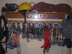 Gear storage - a shelf designed to hang a blanket, added cord to make loops to clip biners