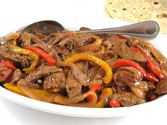 Skinny Steak Fajitas...If you're looking for a simple and delicious recipe for fajitas, your search is over. I'm using lean flank steak and broiling the steak first, before cooking with seasonings, peppers and onions. I love serving fajitas for parties or small gatherings. It's so much fun to let everyone customize their own! The skinny for 1 steak fajita is 200 calories, 7 grams of fat and 5 Weight Watchers POINTS PLUS.