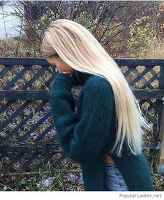 Jeans, green sweater and blonde hair