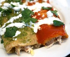 Chicken Enchiladas made with Red Enchilada Sauce and Green Salsa Verde - bringing two different flavors together for one tasty plate!