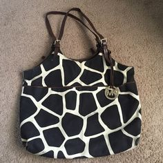 Michael Kors giraffe bag Gently worn in good condition! Has a lot of life left. Small mark shown in second picture. Comes with care tag. Snap closure. Inside zipper compartment with two smaller pockets. No dust bag. The inside is in perfect condition! MICHAEL Michael Kors Bags