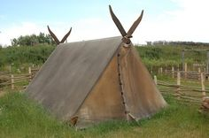 Waxed canvas(?) tent/ this may be canvas, but the viking age would have had only wool and linen, the same substances out of which sails were made.