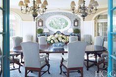 The dining room features oversize chairs covered in a Holland & Sherry and Price Glover Chandeliers.  PGR-105