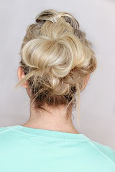 "This is one of my favorite ""mom"" hairstyles.  It takes a couple of minutes and keeps your hair out of your face and off your neck.  The shape of the hairstyle is really pretty and flattering.  It's a great ""I need to wash my hair but just don't have the time"" hairstyle. I couldn't get to a tutorial, so hopefully the step by steps are sufficient. You're going rat/tease where you want your french braid. Smooth down and apply some product or hairspray to get the frizz smooth French braid t..."