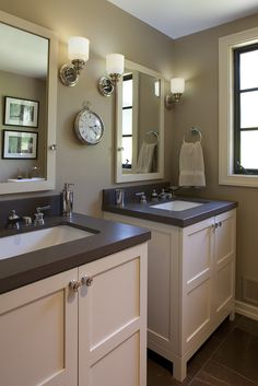 Bathroom: mirrors btw sconces, sep vanities undermount square sink, solid counters