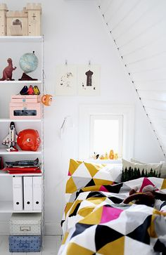 great kids bedroom in the attic, smalll space but love the angled wall..