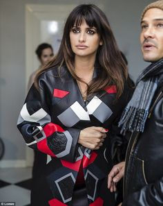 Ready for action: Penelope covers up in a leather patterned coat as she makes her way to the shoot