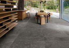 Stunning large black slate effect porcelain tiles which look amazing in any room of the house.  #black #porcelain #tiles