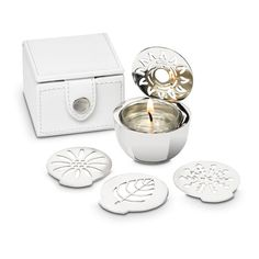 Changing Seasons Travel tealight holder set $25 includes 4 seasonal discs & faux leather case www.partylite.biz/jenswax